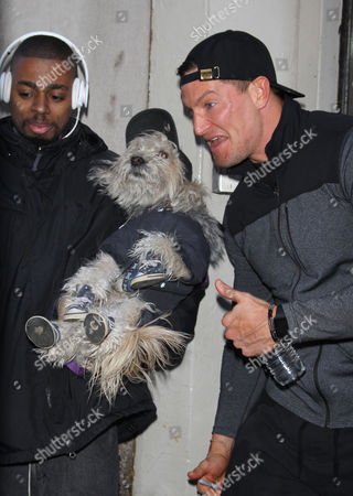 Steve Weatherford with fan and dog
