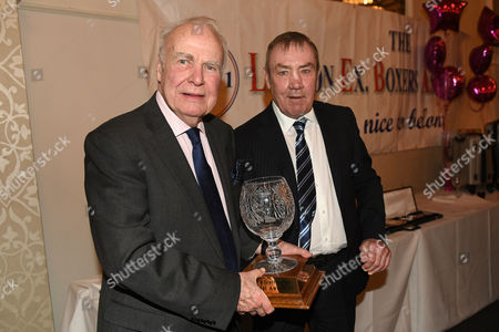 Hugh McIlvanney (L) receives the Reg Gutteridge Award for Services to Boxing Journalism from Alan Minter