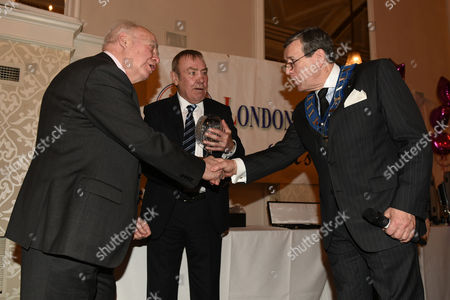 Hugh McIlvanney (L) receives the Reg Gutteridge Award for Services to Boxing Journalism from Stephen Powell (R) and Alan Minter