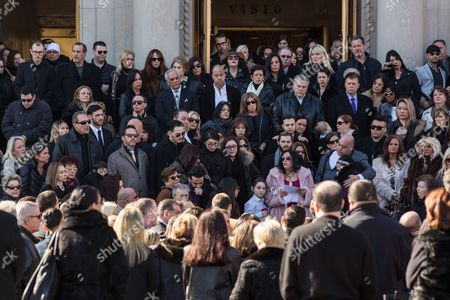 Stock Photo of Dominick Detore (fur coat, sunglasses) reads some final words as the Coffin of Angela Riola is brought out of the Basilica of Regina Pacis on 65th Street in Sunset Park, Brooklyn