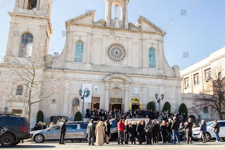 The Coffin of Angela Riola is brought out of the Basilica of Regina Pacis on 65th Street in Sunset Park, Brooklyn