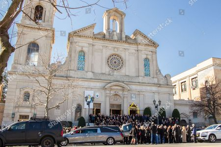 Stock Image of The Coffin of Angela Riola is brought out of the Basilica of Regina Pacis on 65th Street in Sunset Park, Brooklyn