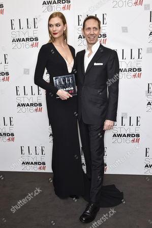 Karlie Kloss (L), winner of the Inspiring Woman of the Year award, and Nick Knight pose in the winners room