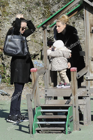 Stock Picture of Michelle Hunziker to the park with her daughters Celeste Trussardi and Aurora Hunziker-Ramazzotti