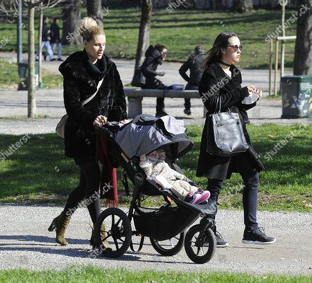 Stock Photo of Michelle Hunziker to the park with her daughters Celeste Trussardi and Aurora Hunziker-Ramazzotti