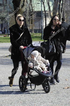 Stock Image of Michelle Hunziker to the park with her daughters Celeste Trussardi and Aurora Hunziker-Ramazzotti