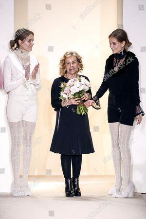 Designer Anna Molinari with models on the catwalk