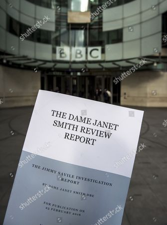 The Dame Janet Smith review found that the BBC repeatedly failed to stop abuse by DJ Jimmy Savile and broadcaster Stuart Hall. A copy of the Dame Janet Smith report held at the front of BBC Broadcasting House in London