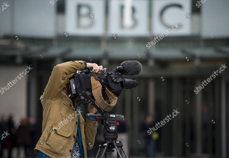 The Dame Janet Smith review found that the BBC repeatedly failed to stop abuse by DJ Jimmy Savile and broadcaster Stuart Hall. A television camera pointed at the front entrance to BBC Broadcasting House in London