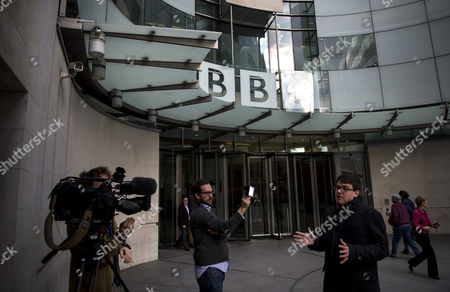 Stock Photo of The Dame Janet Smith review found that the BBC repeatedly failed to stop abuse by DJ Jimmy Savile and broadcaster Stuart Hall. A news crew filming at the front entrance to BBC Broadcasting House in London