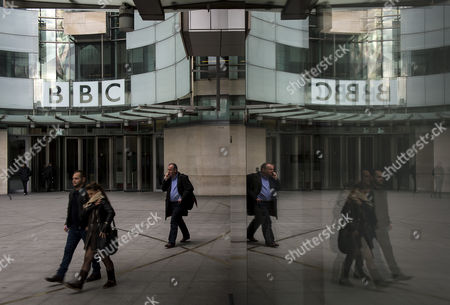 The Dame Janet Smith review found that the BBC repeatedly failed to stop abuse by DJ Jimmy Savile and broadcaster Stuart Hall. A reflection in a window of the front entrance to BBC Broadcasting House in London
