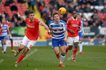 Roger Johnson of Charlton Athletic and Yann Kermorgant of Reading in a midfield tussle
