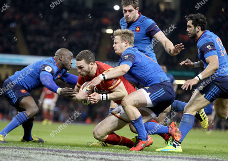 George North collects his grubber kick and beats Djibril Camara, Jules Plisson, Alexandre Flanquart and Maxime Mermoz to score the games opening Try for Wales.