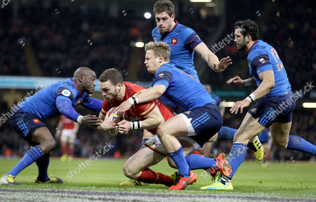 George North collects his grubber kick and beats Djibril Camara, Jules Plisson, Alexandre Flanquart and Maxime Mermoz to score the games opening Try for Wales