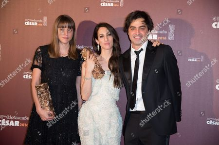 Screenwriter Alice Winocour, Director Deniz Gamze Erguven and producer Charles Gillibert with their trophies for Best First Feature Film award for 'Mustang'