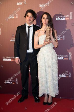 Charles Gillibert and director Deniz Gamze Erguven with their trophies for Best First Feature Film award for 'Mustang'