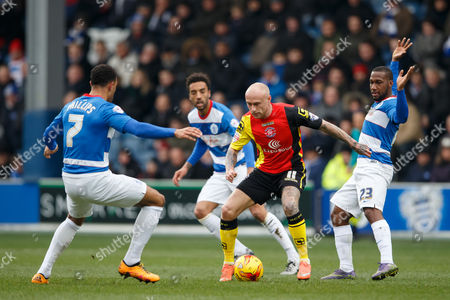David Cotterill of Birmingham City takes on Matt Phillips and David Hoilett of QPR during the SkyBet Championship match between QPR and Birmingham City played at Loftus Road Stadium, London on February 27th 2016