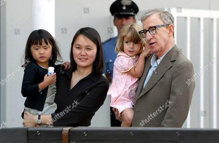 Woody Allen, wife Soon Yi Previn and their two adopted daughters Bechet Dumaine (left) and Manzie Tio