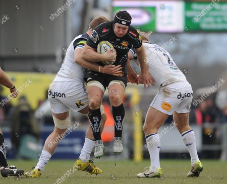 Exeter's Thomas Waldrom is tackled by Bath's Dominic Day and Ross Batty.