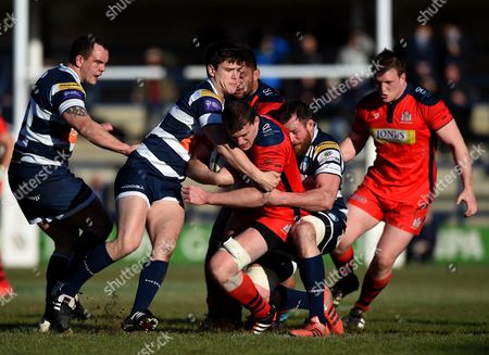 Stock Picture of Yorkshire Carnegie Inside Centre Harry Leonard and Yorkshire Carnegie Lock Dean Schofield tackle Bristol Rugby Lock Ian Evans