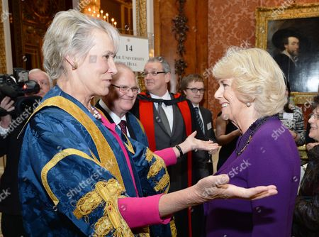 Virginia Bottomley (left) with Camilla Duchess of Cornwall at a reception after the presentation of The Queen's Anniversary Prizes for higher and further education in Buckingham Palace, London.