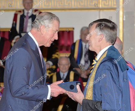 Prince Charles with Professor Sir Peter Gregson of Cranfield University, during the presentation of The Queen's Anniversary Prizes for higher and further education, at a ceremony in Buckingham Palace, London.