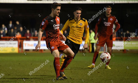 Stock Image of Andy Bond plays the short ball during the Sky Bet League 2 match between Crawley Town and Newport County at the Checkatrade.com Stadium, Crawley