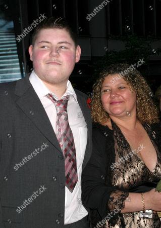 Jamie Waylett with his mother