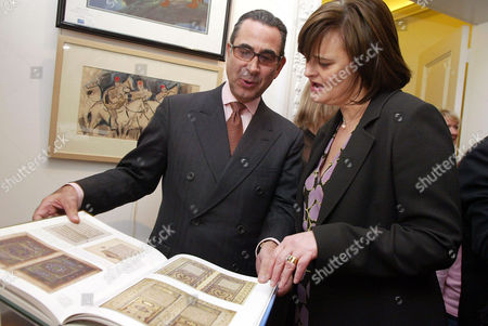 Cherie Blair with author Nasser Khalili looking through his new book