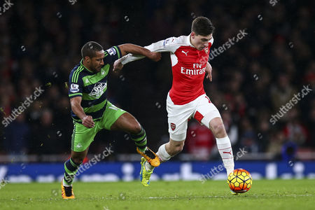 Stock Picture of Hector Bellerin of Arsenal under pressure from Wayne Routledge of Swansea City