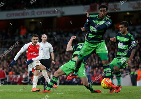 Arsenal's Alexis Sanchez has his shot on goal blocked by Swansea City's Leroy Fer during the Barclays Premier League match between Arsenal and Swansea City played at the Emirates Stadium, London on 2nd March 2016