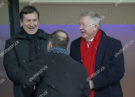LFT-RT JOHN ALEXANDER [SEC]-EDWARD WOODWARD-SIR ALEX FERGUSON TAKE THEIR SEATS BEFORE THE START OF THE MATCH