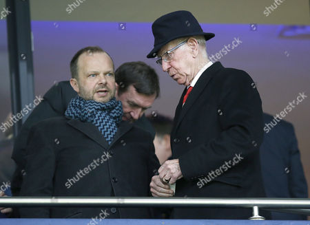 ]-EDWARD WOODWARD AND SIR BOBBY CHARLTON TAKE THEIR SEATS BEFORE THE START OF THE MATCH
