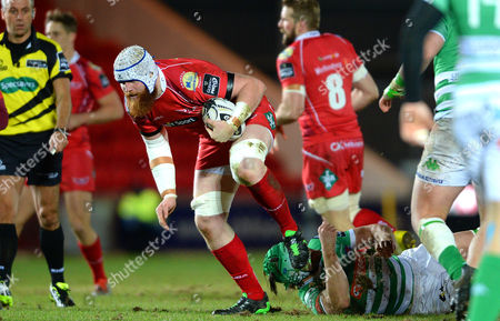Jake Ball of Scarlets is tackled by Tom Palmer of Treviso.