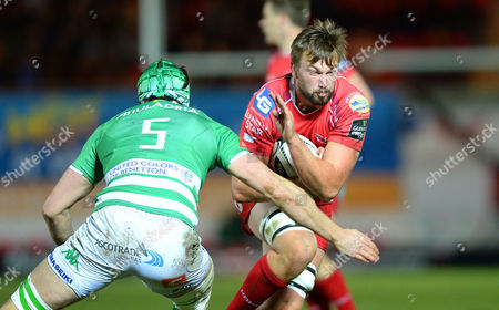 Stock Picture of David Bulbring of Scarlets is tackled by Tom Palmer of Treviso.