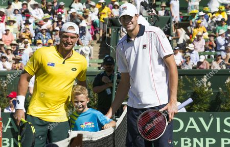 John Isner of the USA with Sam Groth of Australia and Cruz Hewitt at  the Davis Cup tie between Australia and the USA. Held at Kooyong Tennis Club, Melbourne, Victoria, Australia