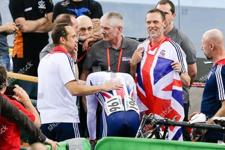 Jason Kenny of GBR throws up in a bin after winning gold against Matthew Glaetzer of AUS in the Men's Sprint Semi Final