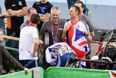 Stock Picture of Jason Kenny of GBR throws up in a bin after winning gold against Matthew Glaetzer of AUS in the Men's Sprint Semi Final