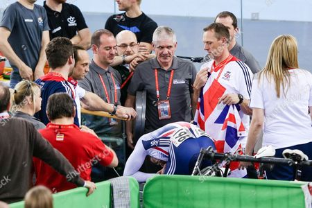 Stock Image of Jason Kenny of GBR throws up in a bin after winning gold against Matthew Glaetzer of AUS in the Men's Sprint Semi Final