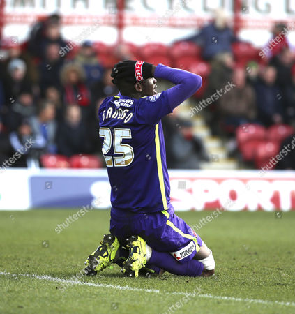 Charlton Athletic striker, Yaya Sanogo (25) on knees looking unhappy during the Sky Bet Championship match between Brentford and Charlton Athletic at Griffin Park, London