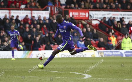 Charlton Athletic striker, Yaya Sanogo (25) shot on goal during the Sky Bet Championship match between Brentford and Charlton Athletic at Griffin Park, London