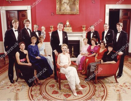 Reagan family portrait in White House Red Room prior to attending the Inaugural Balls following the Presidents Inauguration: (fore,L-R) Davis, Maureen Reagan, Colleen Reagan, Patricia Davis, Patti Davis; Doria Reagan; (rear,L-R) Geoffrey Davis, Dennis Revell, Michael Reagan, Cameron Reagan, Nancy Reagan, Neil Reagan, D.r. Richard Davis, Ron Reagan.  January 21, 1981