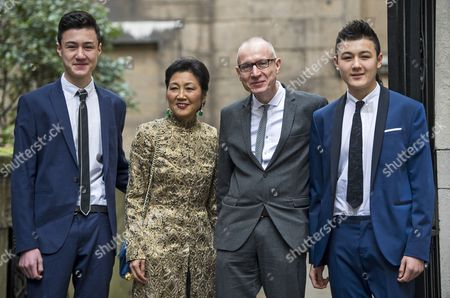 Robert Thomson, wife Wang Ping, sons Luke and Jack