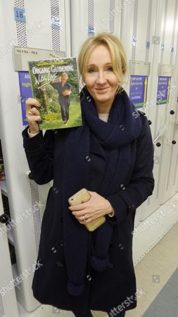 J.K. Rowling with a copy of 'Organic Gardening with Love' by Thelma Barlow at Orkney library