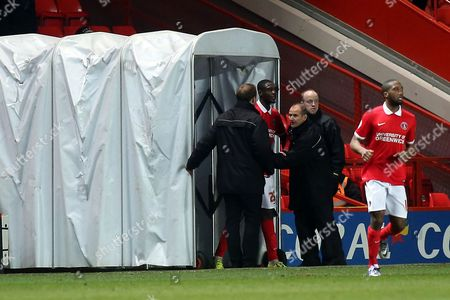 Charlton's Yaya Sanogo lingers in the players tunnel after being sent off. Security staff ensure that he does not return to the field of play during Charlton Athletic vs MK Dons, Sky Bet Championship Football at The Valley, London