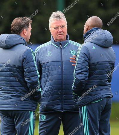 Chelsea manager Guus Hiddink talks with coaches Steve Holland and Eddie Newton during the training session at Cobham, London on March 8th 2016