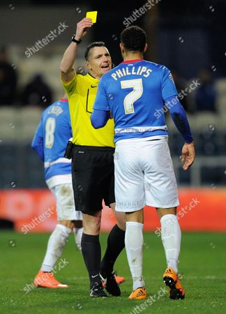 Referee Neil Swarbrick shows Matt Phillips of QPR a yellow card during the sky BET Championship match between QPR and Derby County played at Loftus Road, London on March 8th 2016