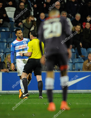 Matt Phillips of QPR talks with Referee Neil Swarbrick after being fouled by Marcus Olsson of Derby County during the sky BET Championship match between QPR and Derby County played at Loftus Road, London on March 8th 2016