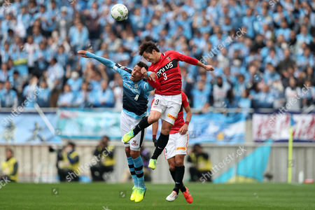 Stock Photo of Jubilo Iwata's Jay Bothroyd (l) jumps for a header with Urawa Reds' Tomoya Ugajin. UK SALES ONLY
