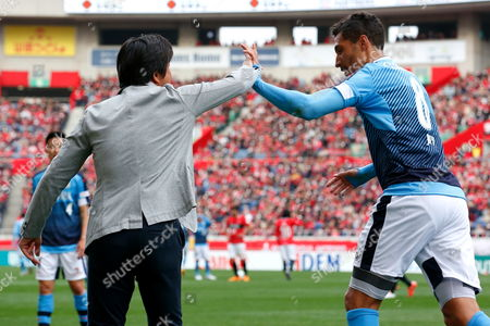 Stock Picture of Jubilo Iwata's Jay Bothroyd (r) celebrates scoring with his manager Hiroshi Nanami (l). Bothroyd became the first Englishman since Gary Lineker to score a J-League goal. UK SALES ONLY